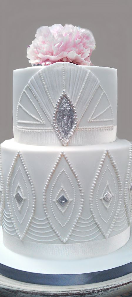 White Art Deco Wedding Cake with Silver Accents and Single Pink Floral Topper