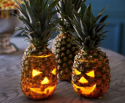 Jack-o'-lanterns are expected—so why not go for the unexpected? Our stylist gave fresh pineapples (an age-old symbol of hospitality) the Halloween treatment to stunning effect. | One Kings Lane