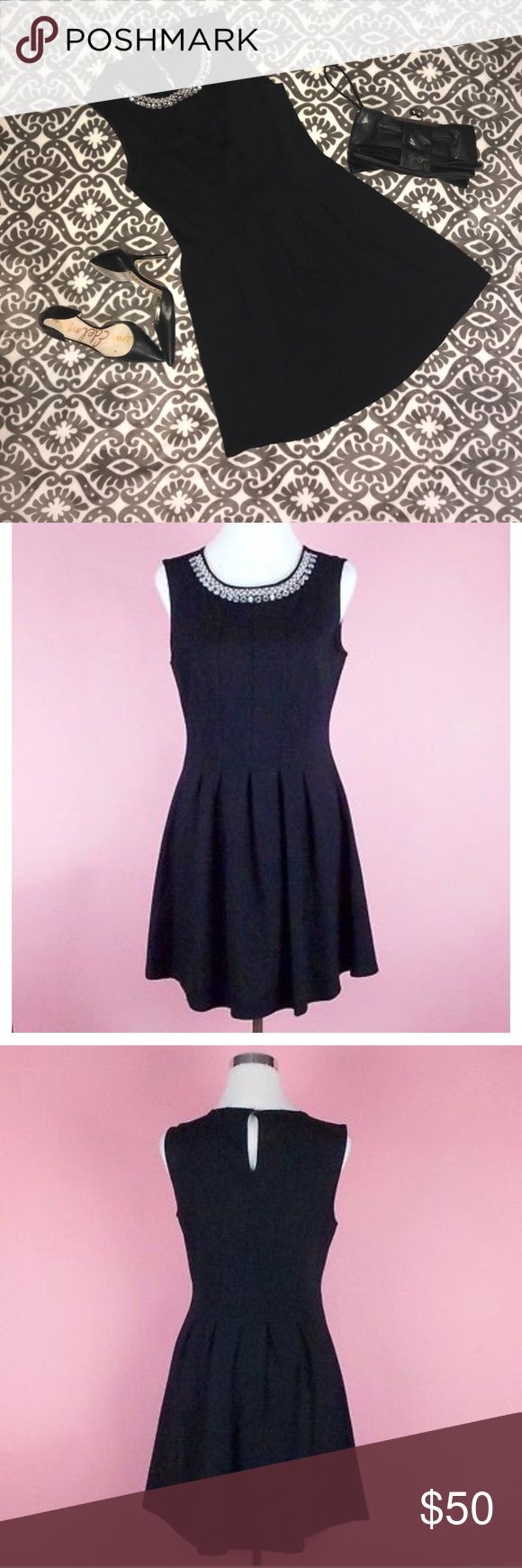 """LITTLE BLACK DRESS  SIZE LARGE NWOT Beautiful little black sleeveless ponte-fit & flare style cocktail dress perfect for any occasion. No need to accessorize with this embellished rhinestone & pearl scoop neckline has a statement necklace built in, just throw on your favorite heels & go! High quality, well made with plenty of attention to detail, material is thicker than most dresses giving luxurious feel. NEVER WORN WAIST: laying flat 16"""" BUST: armpit-armpit 18"""" LENGTH: shoulder to bottom…"""