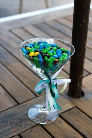 Martini candy wedding centerpiece ~ Cute as a gift filled with Nick  Kim's favorite candy. Guests can take the glass home. Maybe have it inscribed.