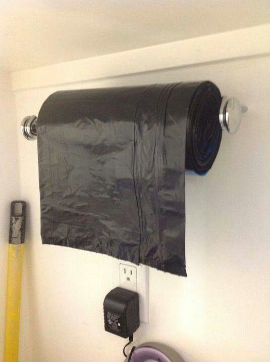 Mount sturdy paper towel holder (or even small bathroom towel rod) in garage for garden/outside bags. No more bulky box.