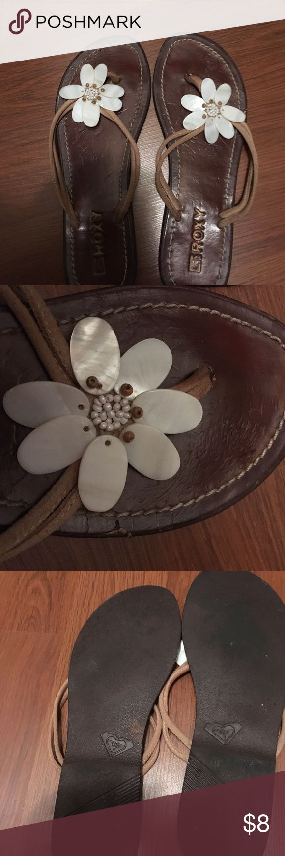 Roxy leather sandals Brown leather sandals. Suede tong with shell floral design. Fair condition and Worn but still has A few more miles to go Roxy Shoes Sandals