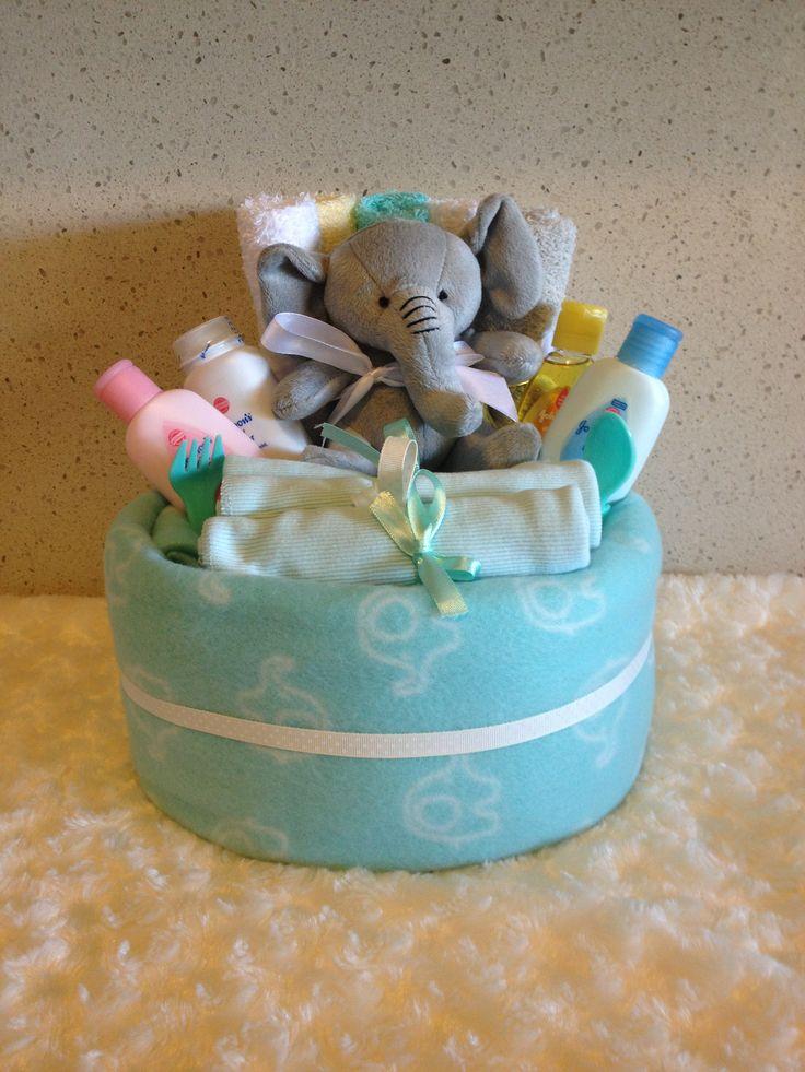 ALICE MINT CAKES Huggies newborn nappies  1 x polar fleece blanket  3 x singlets  4 x mini Johnson bath products  1 x soft toy  5 x facewashers  1 x cutlery set  2 x bibs  Giftwrapped in cello, ribbon and bow