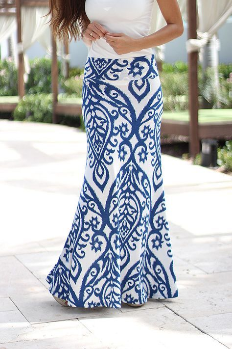 Blue and Ivory Printed Maxi Skirt Love a Maxi skirt. Like that it's more fitted toward the top.