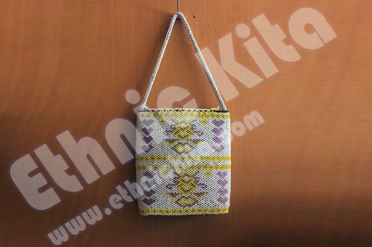 "Beaded Handbags with ""Borneo Motif"".    Measurements : Hight: 30cm x Width: 25cm   Material : Beadeds from kalimantan   Basic Color : White   Motif : Yellow and violet borneo motif   Ethnic Of : Kalimantan, Indonesia"