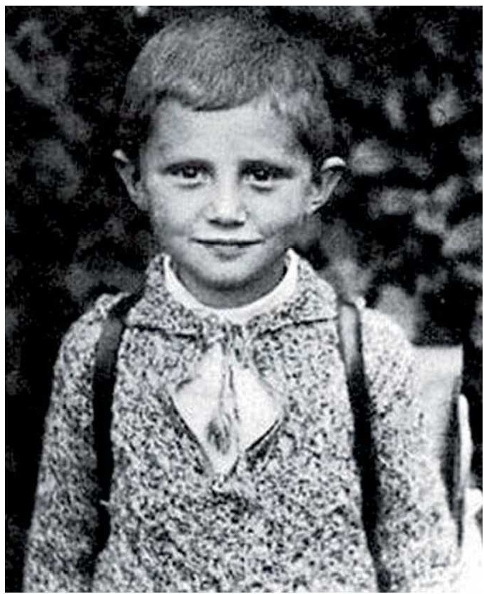 An adorable little Catholic boy named Joseph Aloisius Ratzinger.  You may know him as Pope Benedict