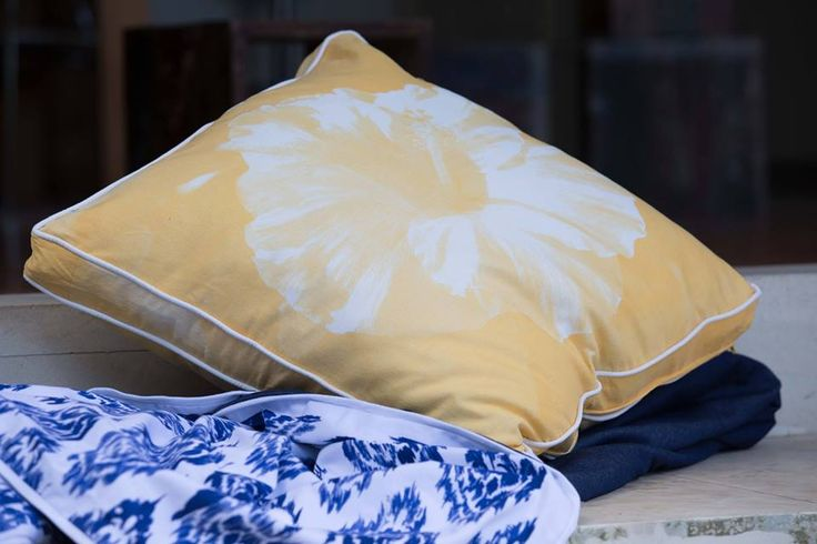 Coca Mojo Hand Printed yellow Hibiscus with luxurious feather inserts at the General Store Furniture Co