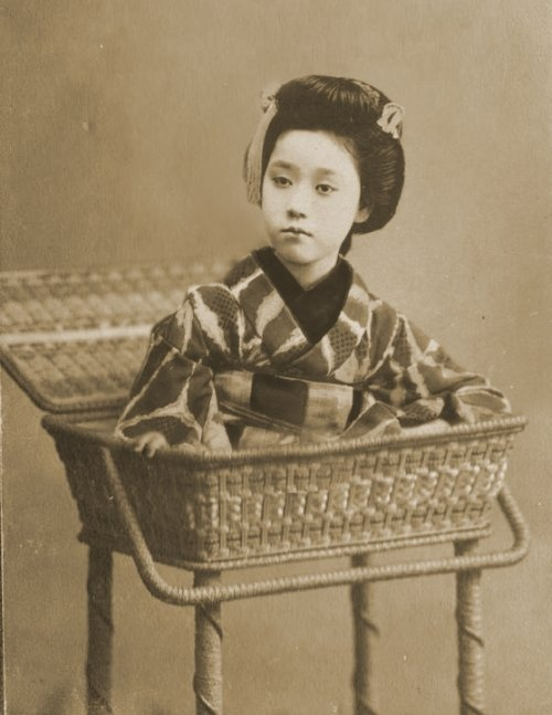 """. This is a vintage photo of Li Yeng, """"The Basket Lady of Weijing Province"""", famed contortionist who dazzled and confounded countless amazed observers while touring the world from 1880-1910 with """"The Circus of the Electric Antlers"""" – an avant-garde troupe of circus performers"""