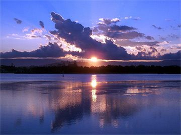 Education for the Australian Curriculum website. The primary focus of this unit of work is a literature study of Dreaming stories and folktales from a variety of cultures, related to the theme of night and day. The students will also explore the scientific concepts of night and day, to build scientific knowledge and understanding of the phenomena.Sunset through clouds over a lake, with a clear blue sky above clouds and the lake shore in darkness