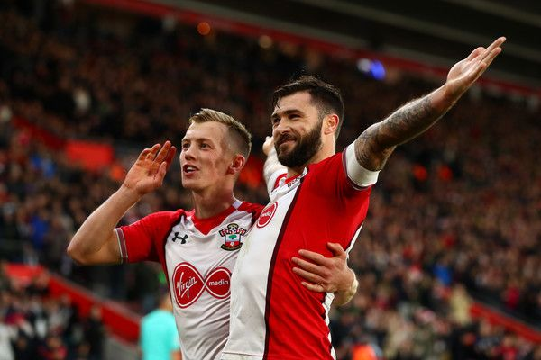 Charlie Austin of Southampto celebrates after scoring his sides first goal with James Ward-Prowse of Southampton during the Premier League match between Southampton and Huddersfield Town at St Mary's Stadium on December 23, 2017 in Southampton, England.