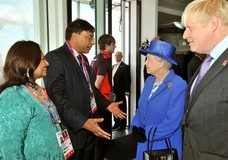 Britain's Queen Elizabeth, accompanied by London Mayor Boris Johnson speaks with Lakshmi Mittal (2nd L) and his wife Usha (L), during her visit to the top of the Orbit at the Olympic Park in London July 28, 2012.