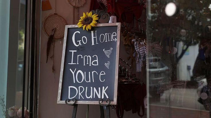 Hurricane Irma   -  A sign in a business reads, 'Go Home Irma Youre Drunk,' as people prepare for the arrival of Hurricane Irma on September 6, 2017 in Miami, Florida. It's still too early to know where the direct impact of the hurricane will take place but the state of Florida is in the area of possible landfall. (Joe Raedle/Getty Images)