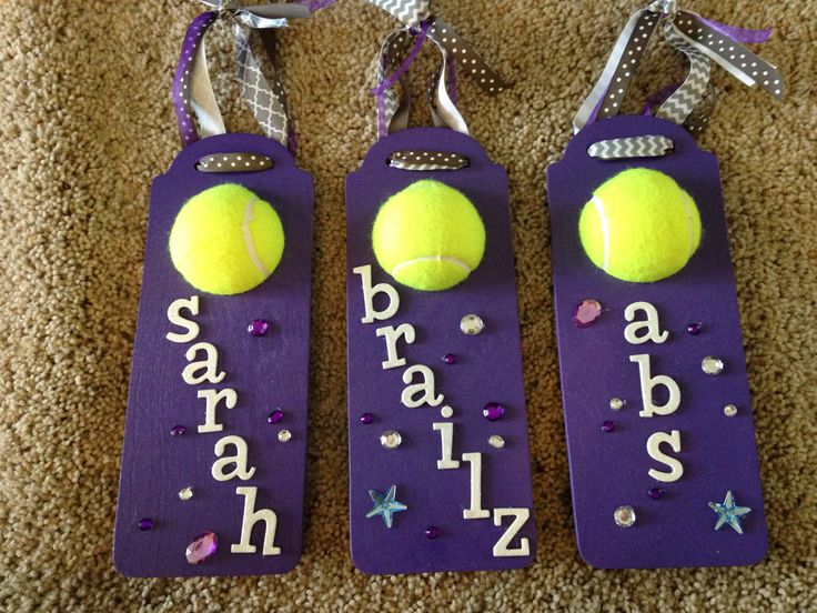 Tennis locker tag hangers. Use wooden door hangers and half of a tennis ball. Glue a clothespin on the back to clip on the locker tags.