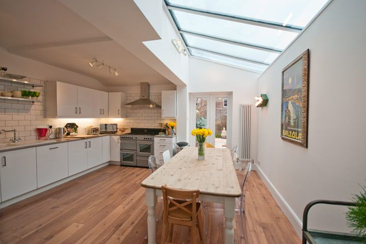 Internal photograph of open plan kitchen overlooking rear garden in Hale Altrincham Cheshire