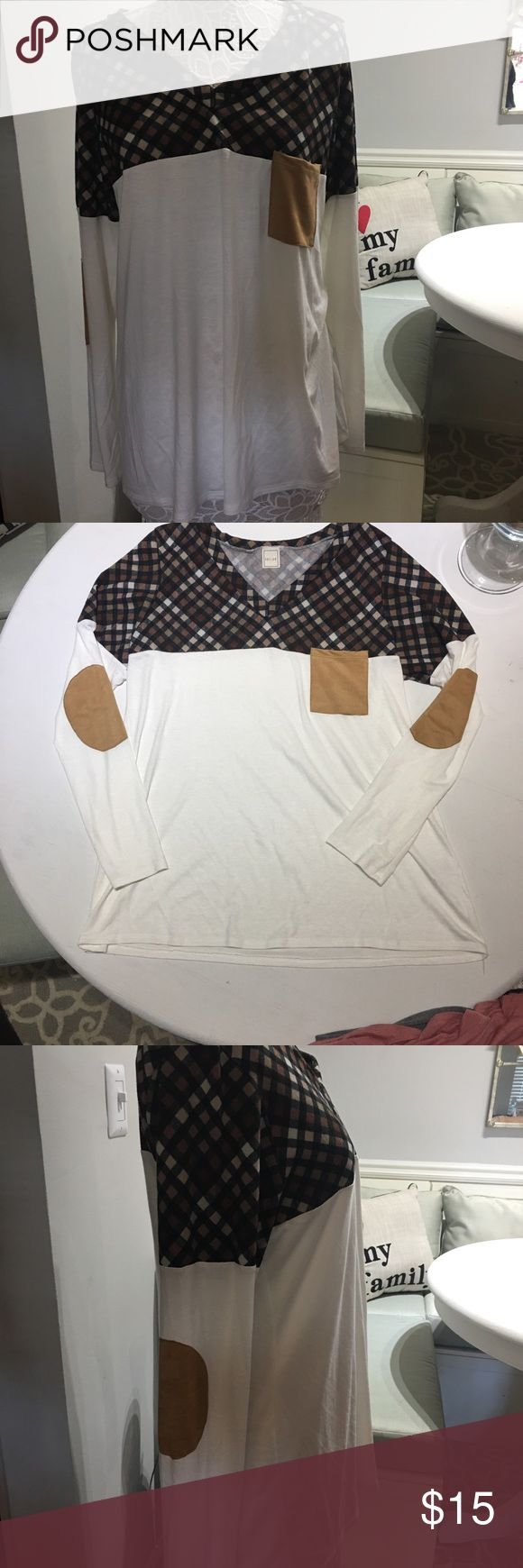 NWOT Plaid & cream long sleeve top w/elbow pads Fits 1-2 sizes smaller than size listed (3XL) not meant to be baggy. Love it, it just doesn't fit my chest at the angle I wanted. Not too tight though, very proportionate. Heshe Tops Tunics