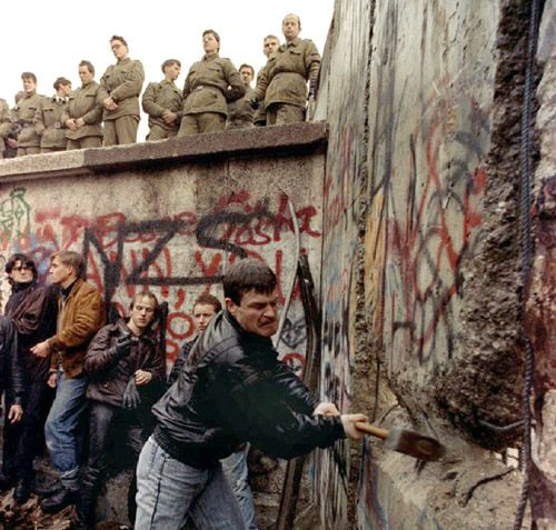 Bringing down the Berlin Wall in the 80s, which led to different fashions from both sides to combine and spread trends.