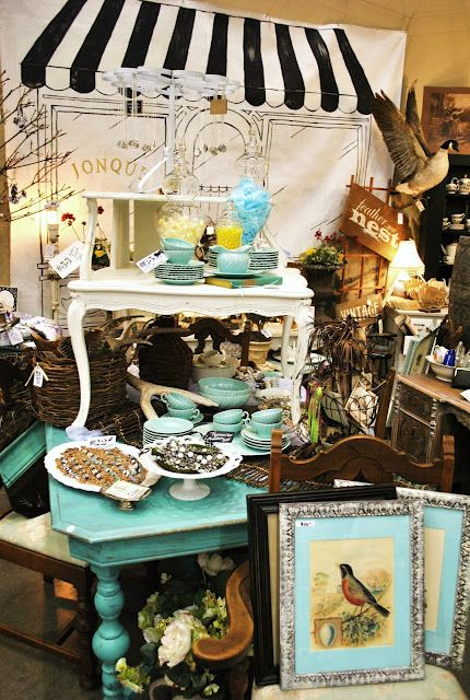 """Turquoise is """"the"""" color of the season.  Here it is used effectively to move the eye around a very monochromatic arrangement of disparate items. The studied arrangement of the color through the display is an effective marketing ploy that translates well to decorating a home."""