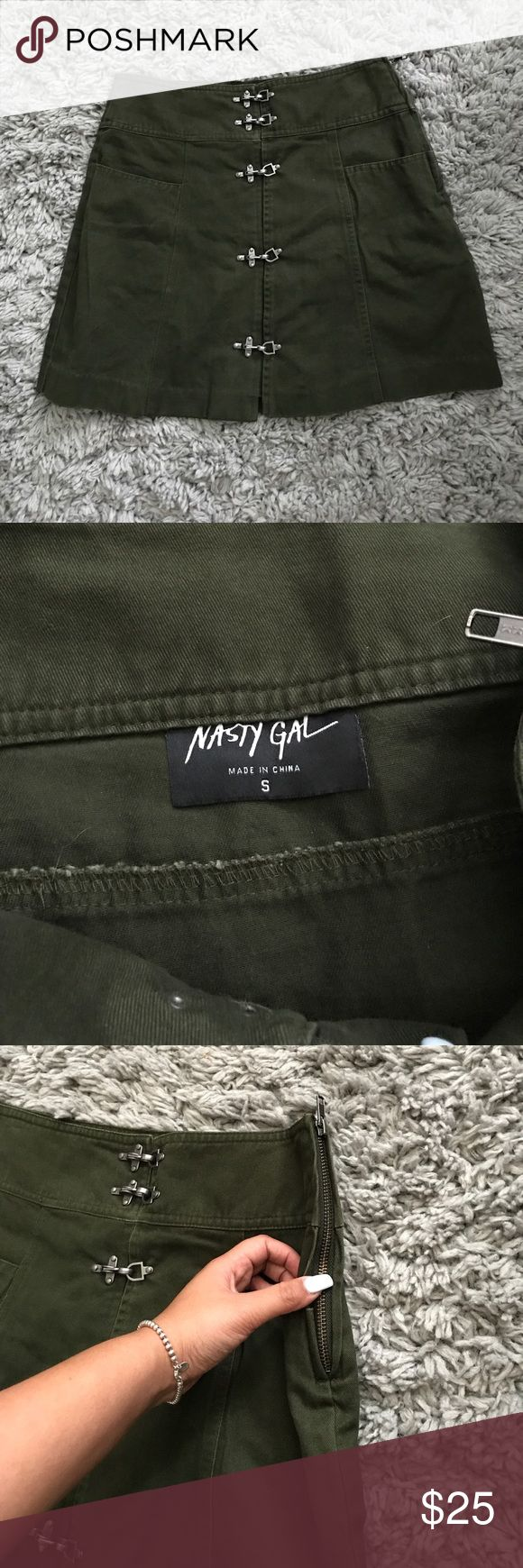 """Nasty Gal skirt Reminds me of a military skirt, the color, the front clasps, and the pockets. Size small best fit up to 25"""". Brand new without tags never worn. Nasty Gal Skirts Mini"""