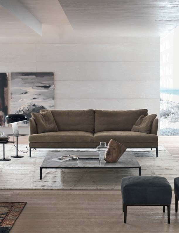 Portofino Sofa by Alivar, Italy can be covered with leather or fabric in a wide range of colours. Wooden frame with polyurethane foam and polyester padding. Polyurethane foam and polyester cushions. Arm and back cushions in feathers. Aluminium structural section frame and die-cast polished or lacquered aluminium feet.	 Manufactured By Alivar.