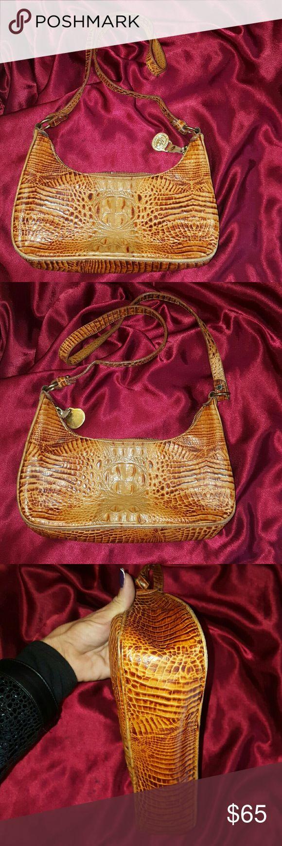 Brahmin blonde pecan gator hobo shoulder bag This is a beautiful authentic Brahmin blonde pecan colored alligator / crocodile hobo shoulder bag purse. It is pre-owned that still has a lifetime of you left. Measures 7 X 10 X 3, strap drop is 17. Brahmin Bags Hobos