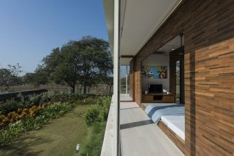 The bedroom opens out onto the garden, which opens onto the lake