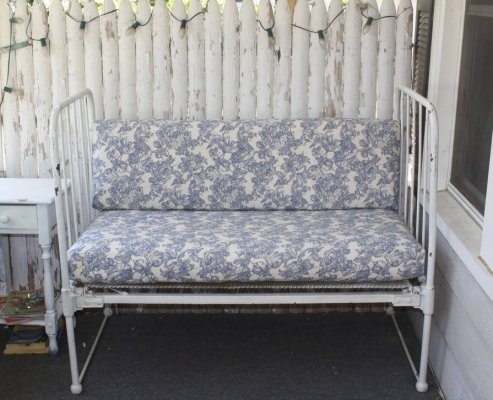 Outdoor seating made from an old iron baby crib