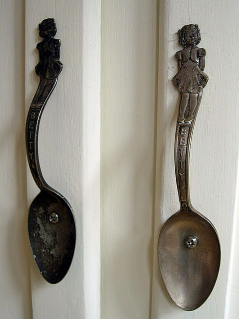 Silverware craft. I persoanlly would use a pipe to make the curves match, then drill holes and mount to kitchen cabinets, or a hutch... or silver spoons for a nursery piece.... or handles on baskets (attach with good wire).