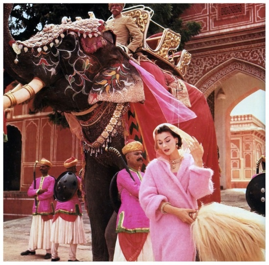 Anne Gunning in a pink mohair coat by Jaeger outside the City Palace, Jaipur, India, Vogue, November 1956 Photo NormanParkinson