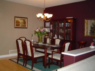 Accent wall colors living room with a red couch for Burgundy dining room ideas