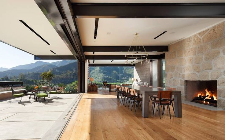 Home entertaining is a breeze here, with a loft-like space anchored by an open kitchen at the heart of the property. In the dining area a 25-foot telescoping glass door retracts to reveal a panoramic view of the Santa Barbara coastline
