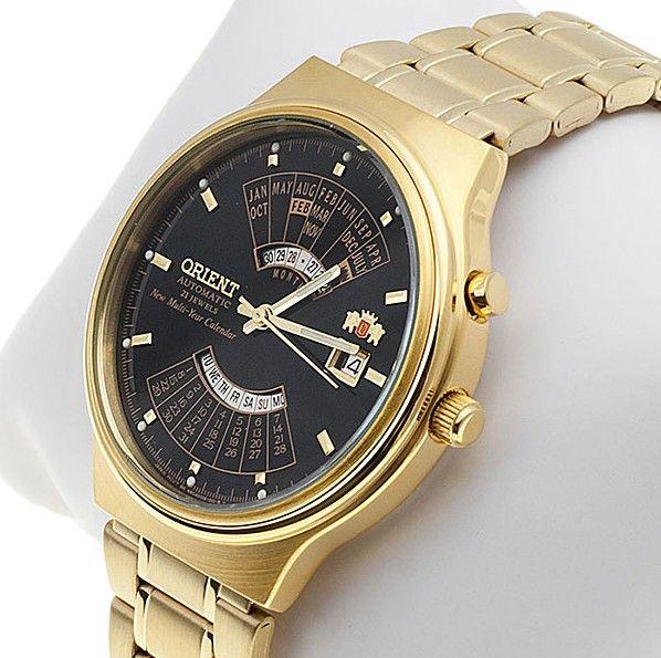 Montre Homme Orient EU00008B automatique, bracelet et boîtier en acier dorés, cadran noir.