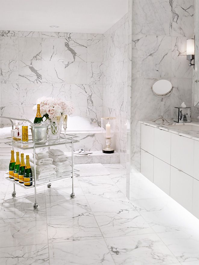 White and grey contemporary bath with streamlined drawers in the vanity. This may not be achievable for most with marble but pretty ceramic tile could work as well.