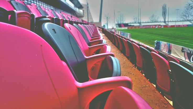 #baseball #bleachers #chairs #close up #color #empty #football #front seats #outdoors #plastic #row #soccer #sports field #stadium #stadium seats #vacant #venue