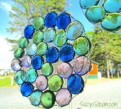 DIY sun catchers made from Dollar Tree gems, plastic yogurt container lids, and clear glue!