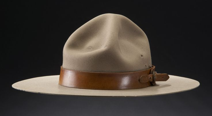 """1905 Royal North-West Mounted Police Cowboy Hat at the Glenbow Museum, Calgary - From the curators' comments: """"Hats were important for protection from the sun and weather on the prairies. The North-West Mounted Police were issued the pillbox shaped forage cap and the Universal helmet, but many preferred the wide brimmed, soft felt hat popular with the western cowboys. Several officers, including Sam Steele, recommended that the cowboy hat become regulation headgear."""""""