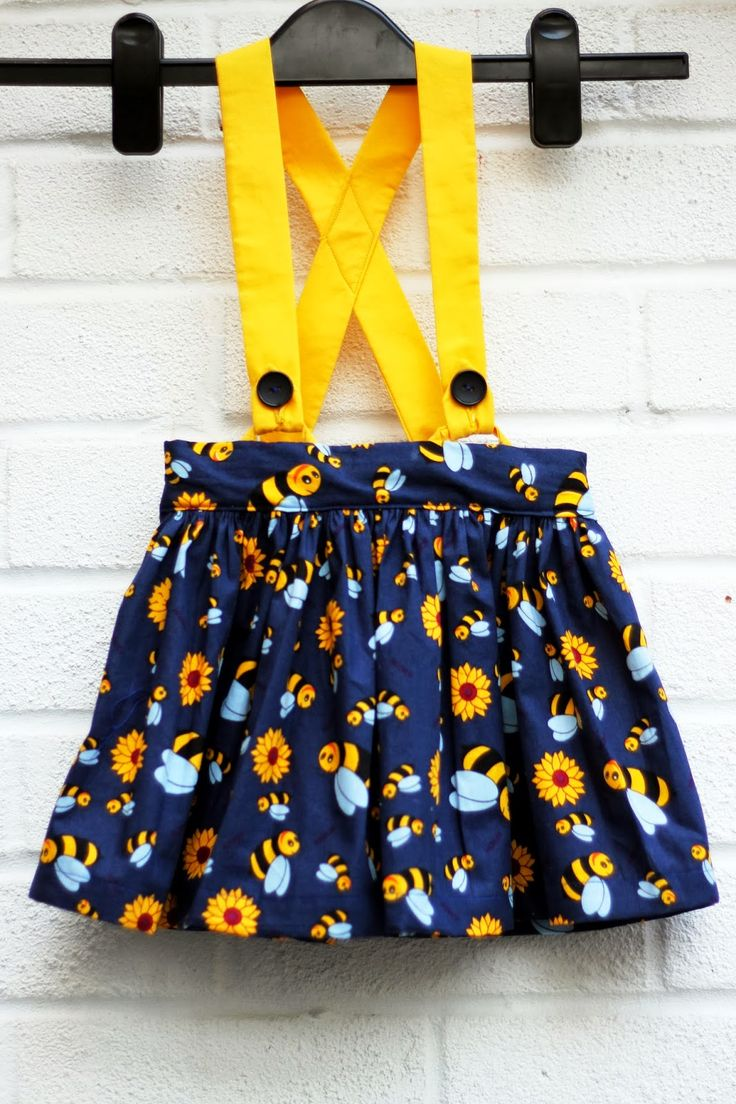 Free gathered skirt sewing pattern - flat front waistband and back elasticized skirt with straps