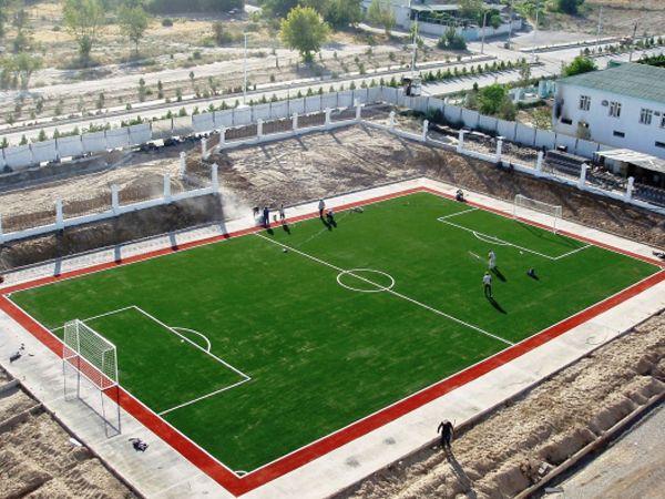 Bauen synthetische kunstrasen fußballplatz