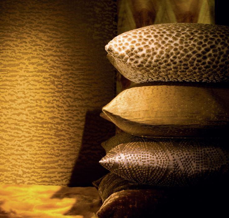 Cushions (from top to bottom): LA PECHE AUX EPONGES, M117801, Textured velvet / ESQUISSE AU MUR, M111908, Textured silk, PACO'S SUIT, M112402, Textured silk / AU MONT DES MUSES, M104007, Iridescent plain velvet / Wallcovering: CLINQUANTE COUPOLE, M102403, Textured wall