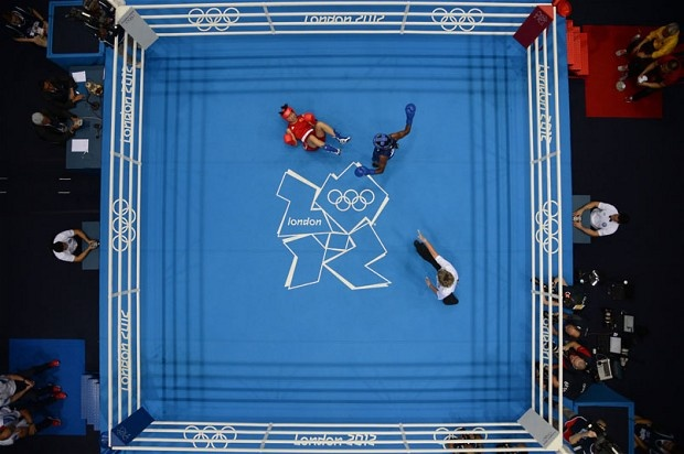 Cancan Ren of China  is knocked down by Nicola Adams of Great Britain  during the women's boxing flyweight final - Picture: JACK GUEZ/AFP/GettyImages
