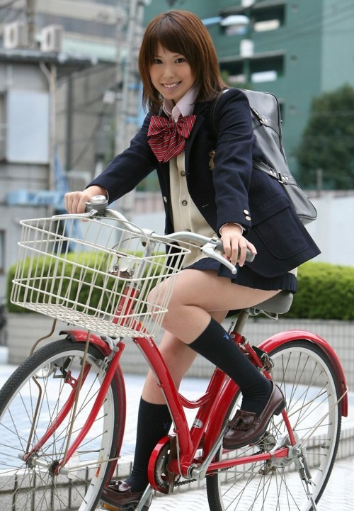 The classic seifuku – blouse, ribbon, blazer, slightly too short skirt, knee high socks and shoes + bicycle, because all students in Japan have a bike.: