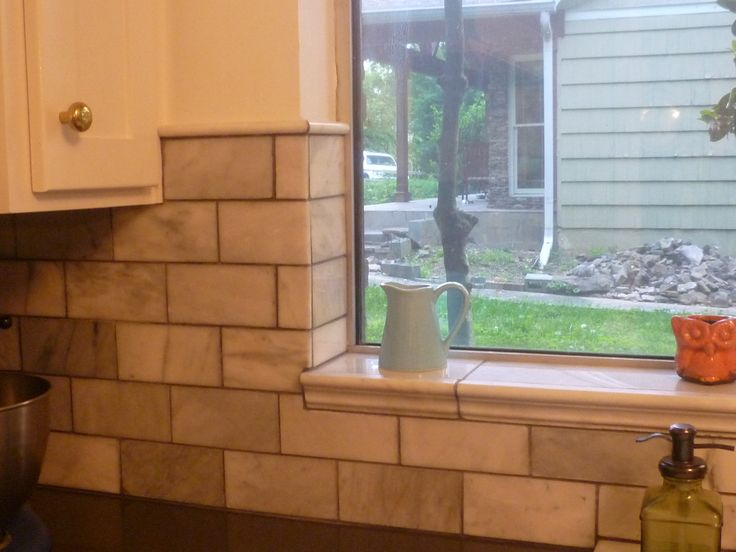 Showing Off The Tile Around Window And Top Of Wall Tiles