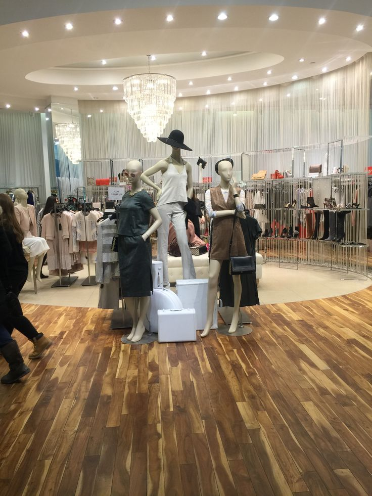 at center of store, there are 3 mannequins. it shows people a collection clothes and some accessories. And they have a theme maybe vacation or travel.