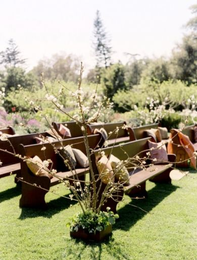 How welcoming! Pews outdoors for wedding ceremony