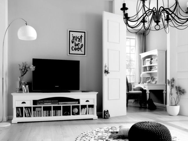 Style tip: don't refine your media cabinet to a single role. It can double up as a coffee table with the right styling, so add literature, a candle or even a photo frame.