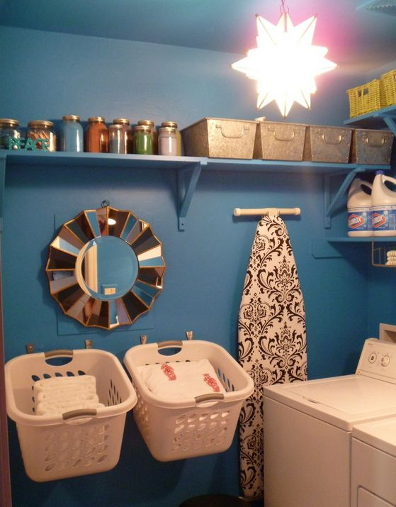11 Creative and Clever Laundry Storage Ideas for Small Spaces  Would be great idea for when you are folding and have no where to put the basket. ~sch