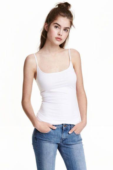 Débardeur long en jersey: Débardeur long en jersey. Modèle ajusté avec fines bretelles réglables.
