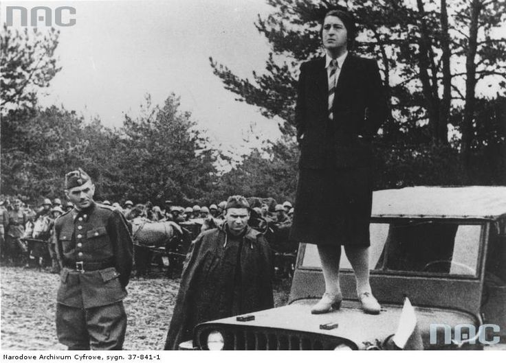 Wanda Wasilewska standing atop a jeep giving a speech to Polish troops of the 1st Tadeusz Kościuszko Infantry Division in Sielce near the Oka River, May 1943.