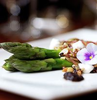 Asparagus, black olive, goats curd, crispy seeds and nuts recipe from Gordon Ramsay's Maze restaurant - hellomagazine.com