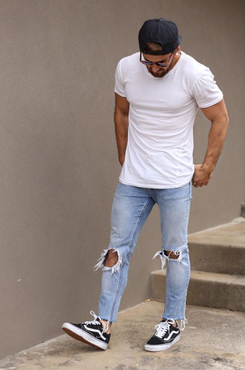 White Plain Tshirt styled with Ripped Jeans and a pair of black converse which is common but yet stylish