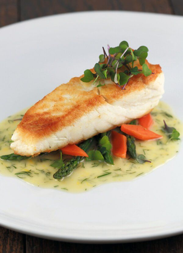 Pan Seared Halibut with Lemon Dill Sauce - Tender golden filets are sautéed and served with a luscious French lemon dill beurre blanc sauce | http://jessicagavin.com
